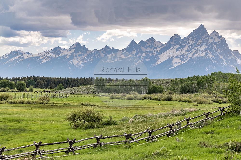 Mount Moran and the Grand Teton mountains at dusk seen across the Moose Head Ranch at the Grand Teton National Park in Moran, Wyoming.