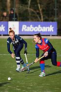 BILTHOVEN -  Hoofdklasse competitiewedstrijd dames, SCHC v hdm, seizoen 2020-2021.<br /> Foto: Pien van der Heide (hdm) en Klaartje de Bruijn (SCHC)