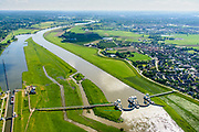 Nederland, Gelderland, Overbetuwe, 29-05-2019; <br /> De stuw bij Driel, bijgenaamd de Kraan van Nederland, zorgt voor afvoer van het water van de Rijn via Nederrijn en Lek. Het stuwensemble is gerenoveerd en gemoderniseerd. Naast de gesloten stuw een schutsluis voor de scheepvaart.<br /> The weir at Driel, nicknamed 'main valve of the Netherlands', provides drainage of water from the Rhine via the Lower Rhine and Lek to the sea. The ensemble of locks and weir has been renovated and modernized.<br /> luchtfoto (toeslag op standard tarieven);<br /> aerial photo (additional fee required);<br /> copyright foto/photo Siebe Swart