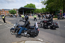 © London News Pictures. 25/05/2013. Woolwich, UK. Over 200 bikers ride to Woolwich Barracks (pictured in background) in South East London to pay tribute to Drummer Lee Rigby and lay flowers.  Drummer Lee Rigby was murdered by two men in Woolwich town centre in what is being described as a terrorist attack. Photo credit: Ben Cawthra/LNP