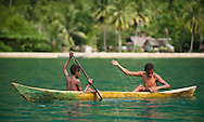 Boys fishing traditionally in front of Lobo Village, Triton Bay, Papua
