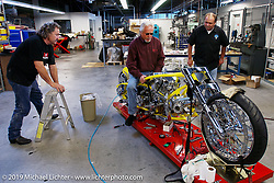 Arlen Ness checks the feel of the new Danny Gray seat for the Top Banana Biker Build-Off bike with Danny (L) and Arlen's brother Kevin (R). Dublin, CA. 2004. Photograph ©2004 Michael Lichter