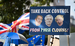 © Licensed to London News Pictures. 09/09/2017. London, UK. A placard mocking Foreign Secretary Boris Johnson, Secretary of State for International Trade Liam Fox and  Secretary of State for Exiting the European Union David Davis is held aloft on the pro EU People's March For Europe in central London. Speakers including Sir Bob Geldof, Sir Ed Davey and Liberal Democrat leader Vince Cable will address a rally in Parliament Square. Photo credit: Peter Macdiarmid/LNP