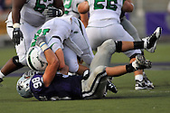 MANHATTAN, KS - AUGUST 30:  MANHATTAN, KS - August 30:  Defensive end Ian Campbell #98 of the Kansas State Wildcats sacks quarterback Giovanni Vizza #15 of the North Texas Mean Green in the second quarter on August 30, 2008 at Bill Snyder Family Stadium in Manhattan, Kansas.  (Photo by Peter G. Aiken/Getty Images)