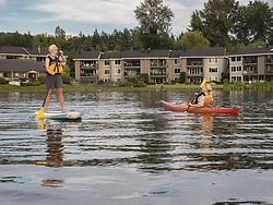 United States, Washignton, Bellevue, kayaking and stand-up paddleboarding in Meydenbauer Bay MR