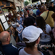 In the city's most crowded streets, the locals feel overwhelmed as they have to push their way through the steady flow of tourists, avoiding obstacles such as the tables and chairs of bar and restaurant terraces.
