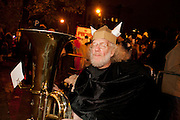 A tuba player cmposes imself before joining the parade