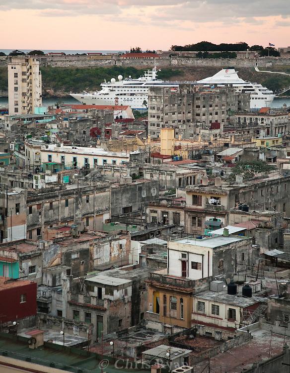 Crusie ship leaving Havana harbor behind the aging buildings of Havana Vieja, Cuba