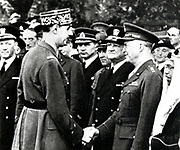 Charles de Gaulle (1890-1970) French General and first President of The Fifth Republic. General de Gaulle greets allied commanders in France including General Dwight Eisenhower (1890-1969) during World War II. Photograph.