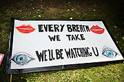 The Air that we Grieve march on July 12th 2019 in East London, United Kingdom. Organised by Extinction Rebellion to draw attention to air pollution and the climate emergency. Banner saying Every breathe we take, well be watching you.