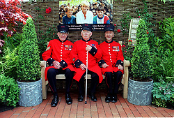 Three Chelsea Pensioners sit on the Diana, Princess of Wales garden bench at the Chelsea Flower Show. The Memorial Fund has agreed to licence the seat in her memory, to help provide jobs in Gradacac, a town on the front line during the war in Bosnia.