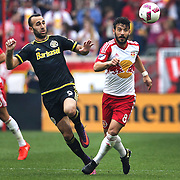 HARRISON, NEW JERSEY- OCTOBER 16:  Justin Meram #9 of Columbus Crew and Felipe Martins #8 of New York Red Bulls challenge for the ball during the New York Red Bulls Vs Columbus Crew SC MLS regular season match at Red Bull Arena, on October 16, 2016 in Harrison, New Jersey. (Photo by Tim Clayton/Corbis via Getty Images)