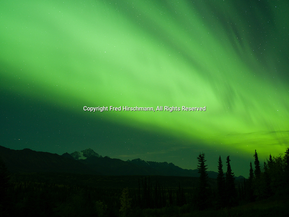 Green northern lights during geomagnetic storm on September 10 and 11, 2018, from solar wind from a coronal hole during solar minimum, sky above Glacier View, Alaska.