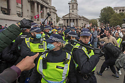Licensed to London News Pictures. 26/09/2020. London, UK. Protestors at Trafalgar Square, central London; demonstrate against lockdown and to stop 5G organised march claiming Covid is a hoax. The 73-year-old meteorologist led more than 10,000 anti-lockdown protesters who believe coronavirus is a hoax at the 'Unite for Freedom'.Photo credit: Marcin Nowak/LNP