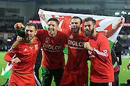 Aaron Ramsey (l), Wayne Hennessey, Gareth Bale and Joe Ledley ® celebrate after the match as the Wales team qualify for Euro 2016 finals in France.  Wales v Andorra, Euro 2016 qualifying match at the Cardiff city stadium  in Cardiff, South Wales  on Tuesday 13th October 2015. <br /> pic by  Andrew Orchard