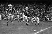 07/09/1975<br /> 09/07/1975<br /> 7 September 1975<br /> All-Ireland Hurling Final: Kilkenny v Galway at Croke Park, Dublin. <br /> Galway goalie, Michael Conneely (right), saves a shot and puts it over the line for a 70. He was watched by Kilkenny full-forward, Kieran Purcell (left) and Galway full-back, Joe Clark (center).