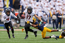 Nov 23, 2019; Morgantown, WV, USA; Oklahoma State Cowboys wide receiver Dillon Stoner (17) runs after a catch and is tackled by West Virginia Mountaineers cornerback Keith Washington Jr. (28) during the fourth quarter at Mountaineer Field at Milan Puskar Stadium. Mandatory Credit: Ben Queen-USA TODAY Sports