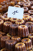 On a street market. Caneles cakes. Bordeaux city, Aquitaine, Gironde, France
