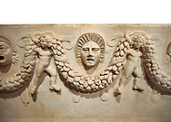 """Close up picture of Roman relief sculpted Sarcophagus of Garlands, 2nd century AD, Perge. This type of sarcophagus is described as a """"Pamphylia Type Sarcophagus"""". It is known that these sarcophagi garlanded tombs originated in Perge and manufactured in the sculptural workshops of Perge. Antalya Archaeology Museum, Turkey.. Against a white background. .<br /> <br /> If you prefer to buy from our ALAMY STOCK LIBRARY page at https://www.alamy.com/portfolio/paul-williams-funkystock/greco-roman-sculptures.html . Type -    Antalya    - into LOWER SEARCH WITHIN GALLERY box - Refine search by adding a subject, place, background colour, etc.<br /> <br /> Visit our ROMAN WORLD PHOTO COLLECTIONS for more photos to download or buy as wall art prints https://funkystock.photoshelter.com/gallery-collection/The-Romans-Art-Artefacts-Antiquities-Historic-Sites-Pictures-Images/C0000r2uLJJo9_s0"""