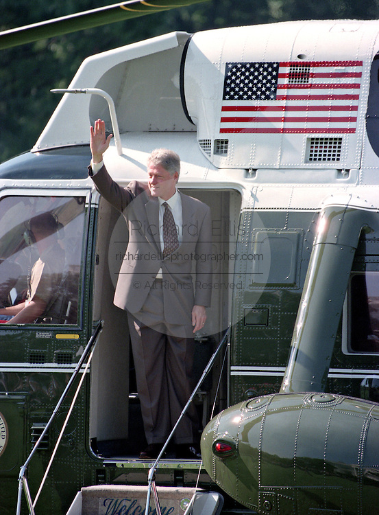 US President Bill Clinton waves as he boards Marine One helicopter as he departs for the Governors Conference in Vermont on the South Lawn of the White House July 31, 1995 in Washington, DC.