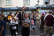 Catching bubbles on Sunday 28th August 2016 at the 50th Notting Hill Carnival in West London. A celebration of West Indian / Caribbean culture and Europes largest street party, festival and parade. Revellers come in their hundreds of thousands to have fun, dance, drink and let go in the brilliant atmosphere. It is led by members of the West Indian / Caribbean community, particularly the Trinidadian and Tobagonian British population, many of whom have lived in the area since the 1950s. The carnival has attracted up to 2 million people in the past and centres around a parade of floats, dancers and sound systems.
