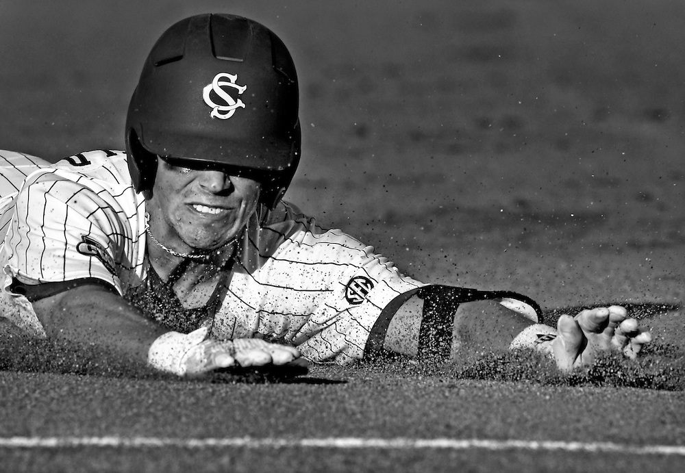 USC's Whit Merrifield slides head first at third after a triple in the fifth as the Gamecocks take on the Clemson Tigers during the 2010 College World Series at Rosenblatt Stadium in Omaha, Neb, Saturday, June 26, 2010.