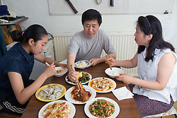 Family enjoying a Chinese meal together,