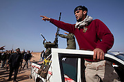 Mcc0030300 . Daily Telegraph..Rebel forces near the front close to the town of Binjawwad. .Gaddafi's forces have been on forced retreat since saturday night due to repeated attacks from NATO airstrikes and are now holding ground approximately.60 miles from Sirt ...Ras Lanuf 27 March 2011