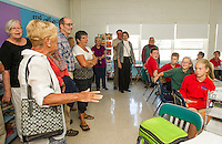 The class of 1962 and current 7th and 8th graders chat about the similarities and differences from what was St. John's and now Holy Trinity School on a reunion tour Friday morning.  (Karen Bobotas/for the Laconia Daily Sun)