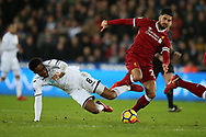 Leroy Fer of Swansea city is tackled by Emre Can of Liverpool ®. Premier league match, Swansea city v Liverpool at the Liberty Stadium in Swansea, South Wales on Monday 22nd January 2018. <br /> pic by  Andrew Orchard, Andrew Orchard sports photography.