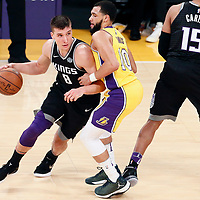 09 January 2018: Sacramento Kings guard Bogdan Bogdanovic (8) drives past Los Angeles Lakers guard Tyler Ennis (10) on a screen set by Sacramento Kings guard Vince Carter (15) during the LA Lakers 99-86 victory over the Sacramento Kings, at the Staples Center, Los Angeles, California, USA.