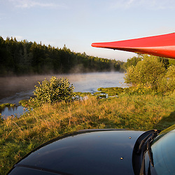 A kayak on a car next to the Androscoggin River at Mollidgewock State Park in Errol, New Hampshire.