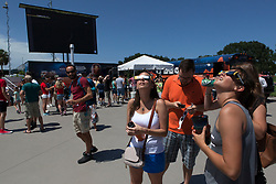 "From the Kennedy Space Center Visitor Complex, guests joined Americans from coast to coast following the solar eclipse. Although a partial eclipse on Florida's Space Coast, young and old alike found many ways to watch the rare astronomical event. As the Moon passed between Earth and the midafternoon Sun, a shadow moved across the landscape. The 70-mile-wide totality path, or ""umbral cone"" -- where the entire Sun will vanish behind the Moon -- stretched across 14 states, from Oregon to South Carolina.  Photo credit: NASA/Ben Smegelsky<br />   Please note: Fees charged by the agency are for the agency's services only, and do not, nor are they intended to, convey to the user any ownership of Copyright or License in the material. The agency does not claim any ownership including but not limited to Copyright or License in the attached material. By publishing this material you expressly agree to indemnify and to hold the agency and its directors, shareholders and employees harmless from any loss, claims, damages, demands, expenses (including legal fees), or any causes of action or allegation against the agency arising out of or connected in any way with publication of the material."