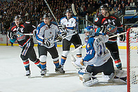 KELOWNA, CANADA, NOVEMBER 25: Jagger Dirk #5 of the Kootenay Ice is checked by Colton Sissons #15 of the Kelowna Rockets in front of the net of Nathan Lieuwen #31 of the Kootenay Ice as the Kootenay Ice visit the Kelowna Rockets  on November 25, 2011 at Prospera Place in Kelowna, British Columbia, Canada (Photo by Marissa Baecker/Shoot the Breeze) *** Local Caption *** Jagger Dirk; Colton Sissons; Nathan Lieuwen;