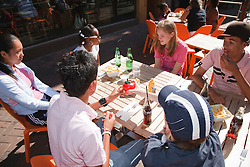 Group of teenagers in cafe.