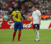 Photo: Chris Ratcliffe.<br /> <br /> England v Ecuador. 2nd Round, FIFA World Cup 2006. 25/06/2006.<br /> <br /> Wayne Rooney of England offers a drink to Ulysses De La Cruz of Ecuador.