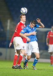 Ross County's Scott Boyd and St Johnstone's Gary Miller.<br /> St Johnstone 2 v 1 Ross County, Scottish Premiership 22/11/2014 at St Johnstone's home ground, McDiarmid Park.