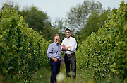 Hermann J. Wiemer Vineyard owners, Fred Merwarth, right, and Oskar Bynke stand between Reisling vines at the vineyard in Dundee, NY, Saturday, July 27, 2013.<br /> CREDIT: Heather Ainsworth for The Wall Street Journal<br /> FINGERLAKESOD