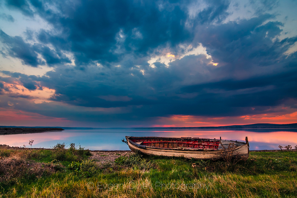 Fishing boat by the lake at twilight
