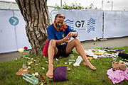 A peaceful one man meditation by activist Alfonso Buller outside the G7 media centre on the 11th of June 2021 in Falmouth in Cornwall, United Kingdom. Over 5000 police officers from forces across the UK are in Cornwall this weekend for the G7 world leaders summit, Alfonso spent time meditation outside the media centre to bring peace to everyone attending.
