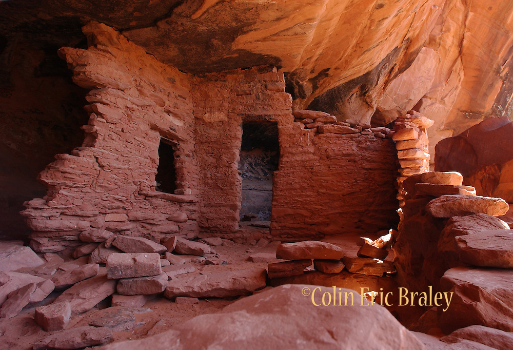 """The remains of an Anasazi dwelling are tucked under a cliff near Bullfrog, Utah. The Anasazi, also referred to as """"the Ancient Ones""""  are a culture that lived in the southwestern United States around 1200 B.C. to 1300 A.D."""