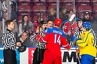 KELOWNA, BC - DECEMBER 18:  Referee Steve Papp sparks to Vitalii Kravtsov #14 of Team Russia and Kirill Marchenko #12 of Team Russia at the start of the game at Prospera Place on December 18, 2018 in Kelowna, Canada. (Photo by Marissa Baecker/Getty Images)***Local Caption***