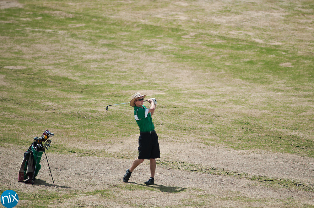 A.L. Brown's Jared Devlieger hits from the fairway during the South Piedmont Conference golf tournament at the Rocky River Golf Club in Concord Monday afternoon. (Photo by James Nix)