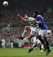 Photo: Paul Thomas.<br /> Glasgow Celtic v Glasgow Rangers. Bank of Scotland Scottish Premier League. 11/03/2007.<br /> <br /> Jan Vennegor (L) of Celtic wins a header from Ugo Ehiogu.