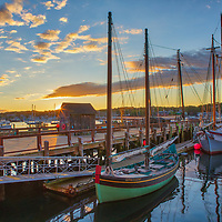New England harbor scenery of Maritime Gloucester and its schooners at sunrise in hours at Gloucester on Cape Ann, Massachusetts.<br /> <br /> Inspiring Cape Ann sunrise photography pictures of Maritime Gloucester Harbor are available as museum quality photography prints, canvas prints, acrylic prints, wood prints or metal prints. Fine art prints may be framed and matted to the individual liking and interior design decorating needs.<br /> <br /> Good light and happy photo making!<br /> <br /> My best,<br /> <br /> Juergen