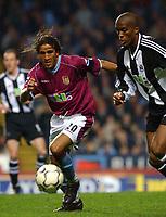 Fotball. Engelsk Premier League 02.04.2002.<br /> Aston Villa v Newcastle.<br /> Sylvain Distin, Newcastle.<br /> Moustapha Hadji, Aston Villa.<br /> Foto: Tim Parker, Digitalsport.