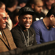 Floyd Mayweather watches his fighter during Showtime Televisions ShoBox:The Next Generation boxing match at the Event Center at Turning Stone Resort Casino on Friday, February 28, 2014 in Verona, New York.  (AP Photo/Alex Menendez)