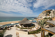 A view of a pool bar at Capella Pedregal Hotel & Resort in Cabo San Lucas, overlooking a plunge pool and the infinite Pacific Ocean. Ideal spot for vacations in Mexico.