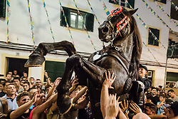 July 29, 2017 - Es Migjorn Gran, Balearic Islands, Spain - A 'caixer' (horse rider) rears up on his horse in between the cheering crowd during the 'Jaleo' of the traditional 'Sant Cristofol' (Saint Christopher) festival in Es Migjorn Gran, the town's patron saint fiesta. (Credit Image: © Matthias Oesterle via ZUMA Wire)