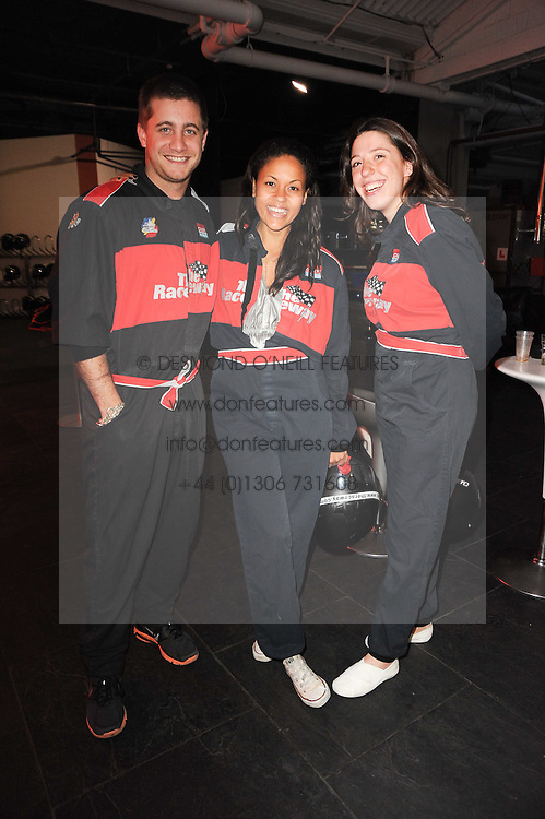 Left to right, TYRONE WOOD, RACHAEL BARRETT and VICTORIA AL-BIN at an evening of go-karting hosted by Tag Heuer at Docklands Raceway, 3 Herringham Road, London SE7 on 16th June 2010.